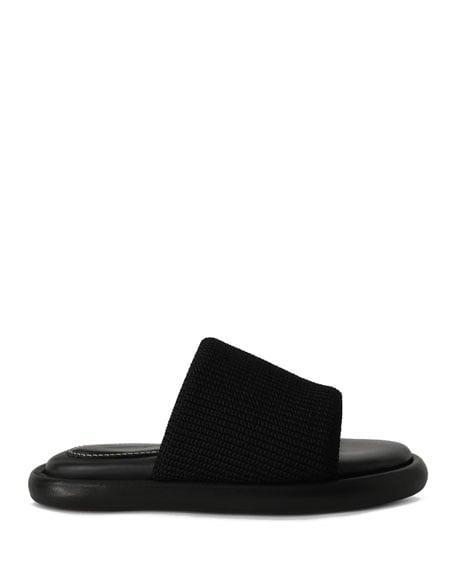 <p>Don't let the leather sole fool you. Between the thick knit strap and cushioned footbed, these <span>Proenza Schouler Pipe Knit Slide Sandals</span> ($725) are the definition of comfort. </p>