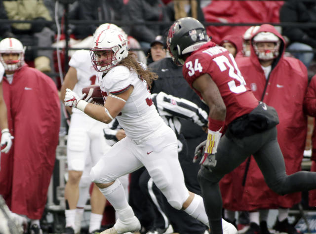 "When he's not blocking for <a class=""link rapid-noclick-resp"" href=""/ncaaf/players/257525/"" data-ylk=""slk:Bryce Love"">Bryce Love</a>, Stanford fullback <a class=""link rapid-noclick-resp"" href=""/ncaaf/players/240503/"" data-ylk=""slk:Daniel Marx"">Daniel Marx</a> will occasionally touch the ball. (AP Photo/Young Kwak)"
