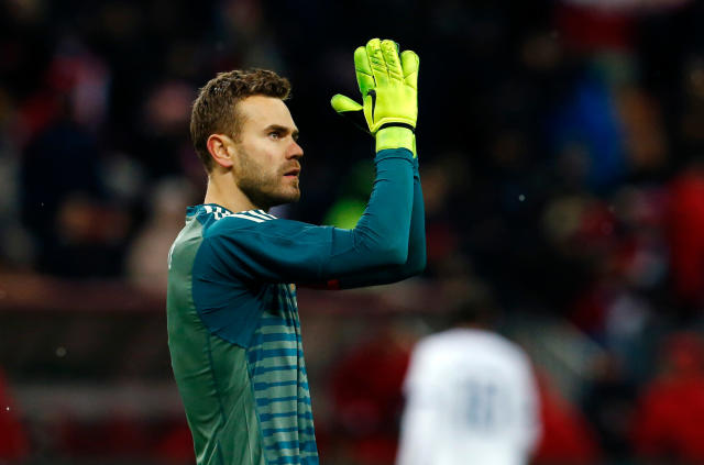FILE - In this Friday, March 23, 2018 file photo, Russia goalkeeper Igor Akinfeev applauds supporters at the end of an international friendly soccer match between Russia and Brazil at the Luzhniki stadium in Moscow.(AP Photo/Alexander Zemlianichenko, File)