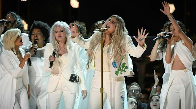 "Kesha recruited Camila Cabello, Cyndi Lauper, Andra Day, and more for a stunning take on her comeback hit ""Praying"" at the Grammys."