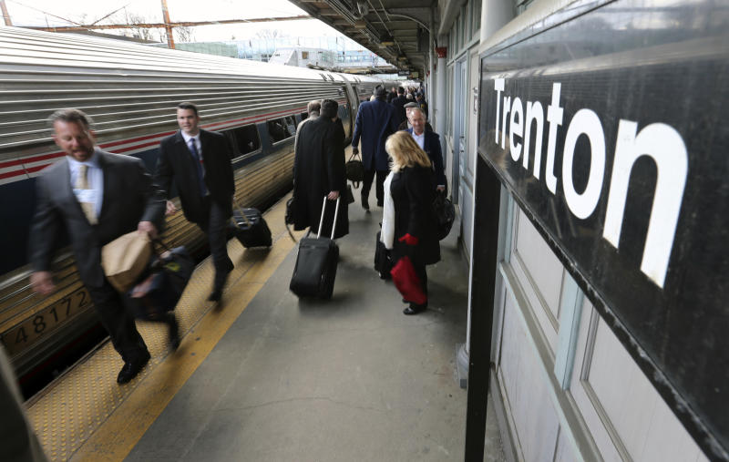 "Some of the 1,000 lobbyists, business owners and politicians rush to their assigned cars of the train taking them to Washington, Thursday, Feb. 16, 2017, in Trenton, N.J. The state Chamber of Commerce's 80th annual trip — nicknamed the ""Walk to Washington"" because rail riders generally pace the train's corridors schmoozing and handing out business cards — comes after a national election that hinged in part on repudiating insiders and establishment politics. (AP Photo/Mel Evans)"