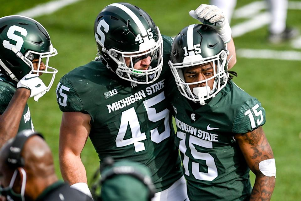 Michigan State's Angelo Grose, right, celebrates a tackle with teammate Noah Harvey during the second quarter of the game against Indiana on Saturday, Nov. 14, 2020, at Spartan Stadium in East Lansing.