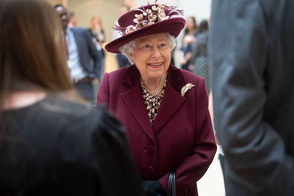 <p>Queen Elizabeth speaks with MI5 officers during a covert visit to the agency's headquarters in February.</p>