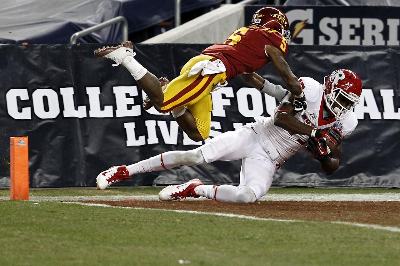 NEW YORK - DECEMBER 30:  Brandon Coleman #17 of the Rutgers Scarlet Knights scores a touchdown in front of Jeremy Reeves #5 of the Iowa State Cyclones during the New Era Pinstripe Bowl at Yankee Stadium on December 30, 2011 in the Bronx Borough of New York City.  (Photo by Jeff Zelevansky/Getty Images)