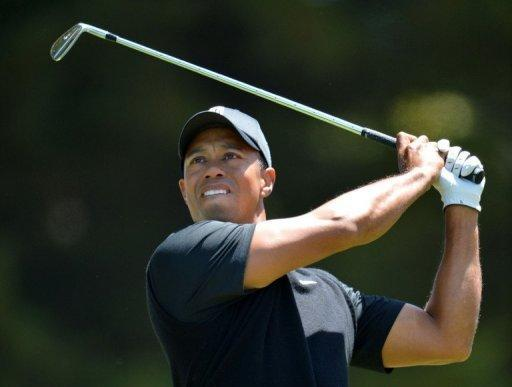 Tiger Woods of the US watches his tee shot during the second round of the 112th US Open at The Olympic Club in San Francisco, California. Woods briefly seized the lead early in the round, but he was soon back in a pack that included 17-year-old US amateur Beau Hossler