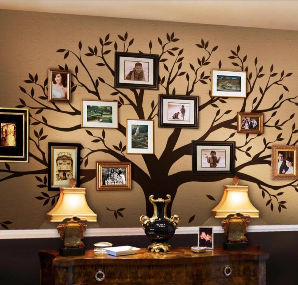"""$149; buy now at <a href=""""https://fave.co/2ZJfMD6"""" target=""""_blank"""">Home Depot</a>  If your grandparents love having family pictures around the house but have filled up practically every mantle and bookcase top with frames, this family tree wall decal is a perfect gift. At nearly nine feet tall and over seven feet wide, it's a stunning focal point for a living room or entryway and has plenty of room for new frames as that collection of family photos grows."""