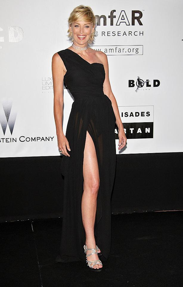 """Sharon Stone donned an asymmetrical Dior dress to host the 16th annual event, which was attended by 800 guests at the Hotel du Cap in Antibes. Daniele Venturelli/<a href=""""http://www.wireimage.com"""" target=""""new"""">WireImage.com</a> - May 21, 2009"""