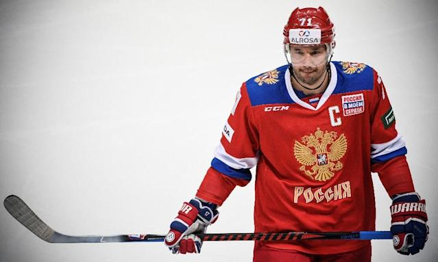 "Russian players will compete as ""Olympic Athletes from Russia,"" but captain Ilya Kovalchuk said the IOC ban may have taken ""our flag and anthem"" but ""not our honor and convictions"" (AFP Photo/Alexander NEMENOV)"