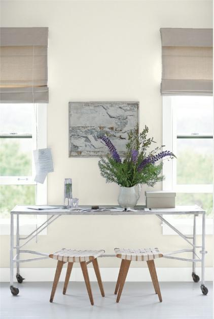 """<p>When all else fails, you can always count on a coat of off-white paint to score a clean (and distraction-free) home office palette. """"Warm off-whites, such as <a href=""""https://www.benjaminmoore.com/en-us/color-overview/find-your-color/color/oc-18/dove-wing?color=OC-18"""" rel=""""nofollow noopener"""" target=""""_blank"""" data-ylk=""""slk:Dove Wing OC-18"""" class=""""link rapid-noclick-resp"""">Dove Wing OC-18</a>, are soft and easy on the eyes,"""" says Yeo. """"They also make a great backdrop color to decorate with to spark creativity.""""</p>"""
