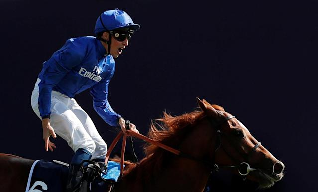 Horse Racing - Derby Festival - Epsom Downs Racecourse, Epsom, Britain - June 2, 2018 William Buick celebrates on Masar after winning the 4.30 Investec Derby Action Images via Reuters/Andrew Boyers