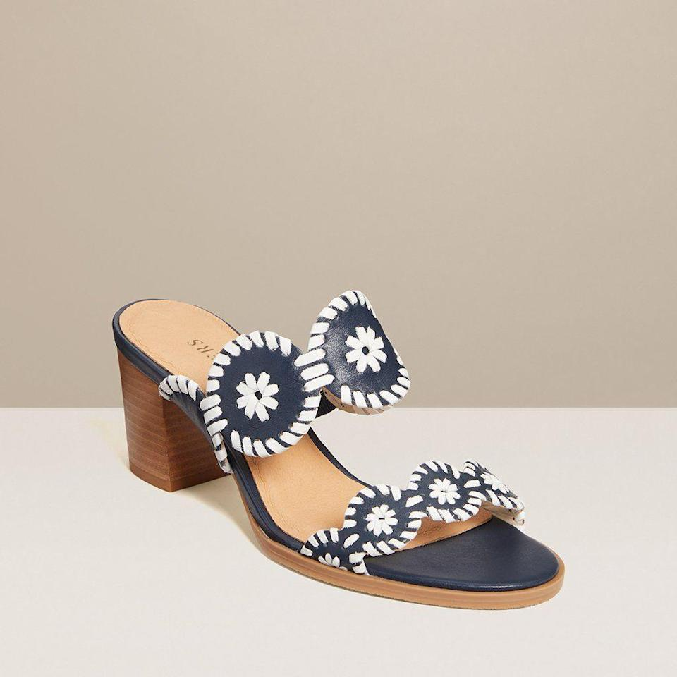 "<p>jackrogersusa.com</p><p><a href=""https://go.redirectingat.com?id=74968X1596630&url=https%3A%2F%2Fwww.jackrogersusa.com%2Fproducts%2Flauren-mid-heel-midnight-white&sref=https%3A%2F%2Fwww.townandcountrymag.com%2Fstyle%2Ffashion-trends%2Fg35863950%2Fjack-roger-spring-2021-sale%2F"" rel=""nofollow noopener"" target=""_blank"" data-ylk=""slk:Shop Now"" class=""link rapid-noclick-resp"">Shop Now</a></p><p>$111</p><p><em>Original Price: $148</em></p>"