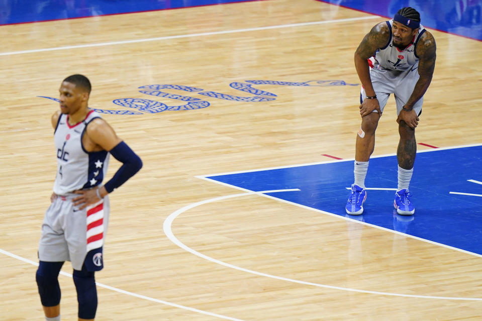 Washington Wizards' Bradley Beal, right, and Russell Westbrook watch as the Philadelphia 76ers attempt a free-throw during the second half of Game 5 in a first-round NBA basketball playoff series, Wednesday, June 2, 2021, in Philadelphia. (AP Photo/Matt Slocum)
