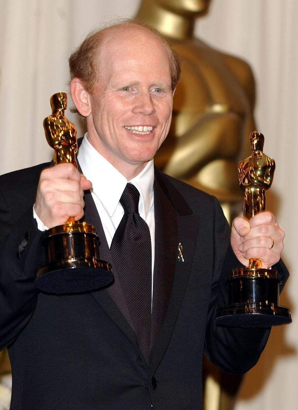 Ron Howard with his Best Director and Best Film awards for A Beautiful Mind at the 74th Annual Academy Awards (Oscars) at the Kodak Theatre in Hollywood, Los Angeles.