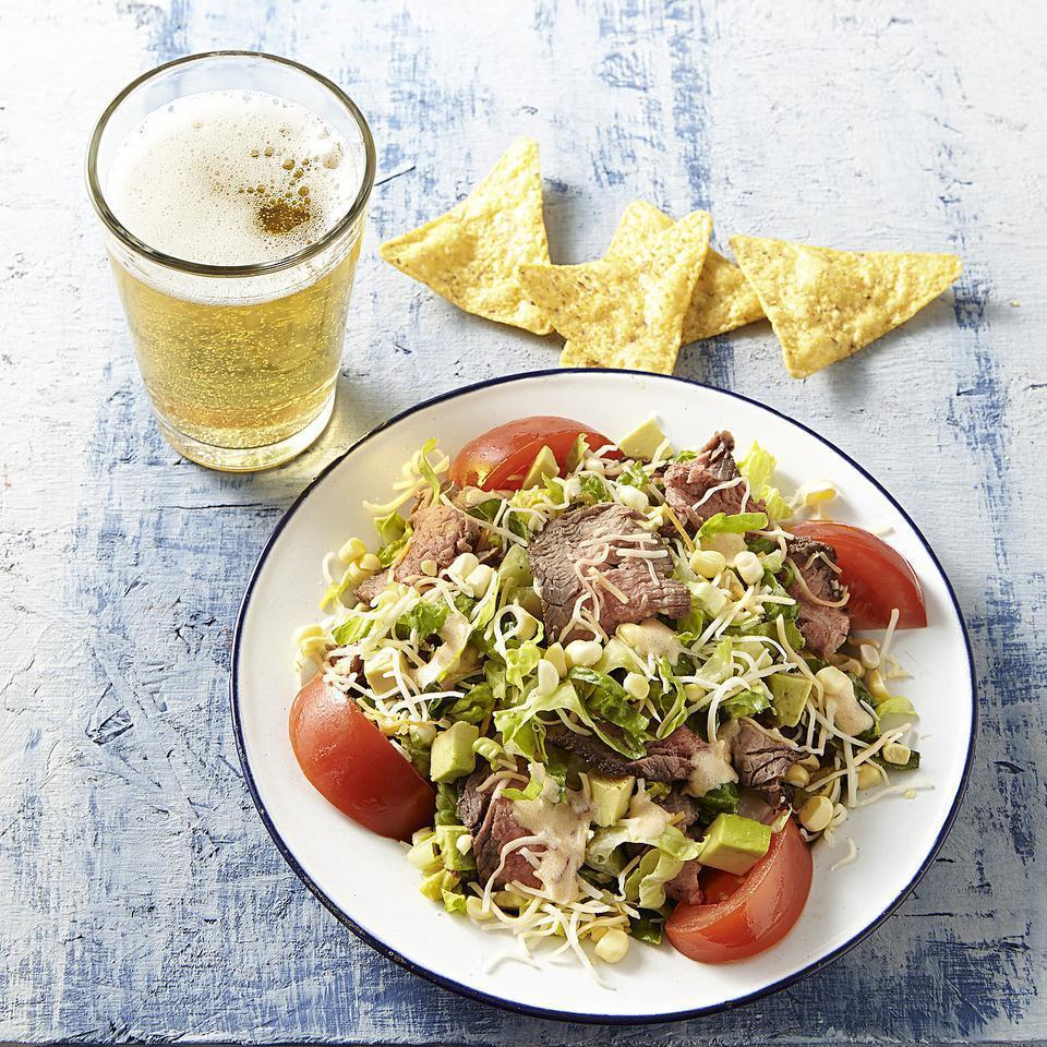<p>This steak salad recipe is packed with fresh summer corn, ripe tomatoes and silky avocado. It might be hard to imagine that this healthy dinner can be whipped up so quickly but the secret is in the timing. While the steak is cooking under the broiler, you'll have plenty of time to whisk together the lightened-up creamy chipotle dressing and assemble the rest of the salad. Serve with crumbled tortilla chips for an extra crunch.</p>