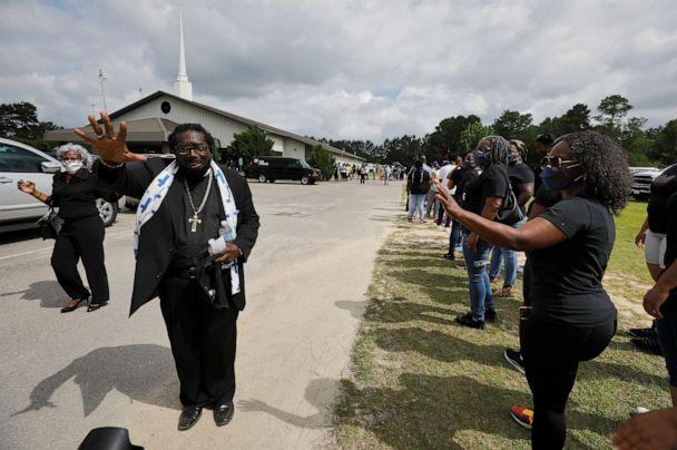 PHOTO: Reverend Raymond Johnson consoles mourners as they line up for the public viewing of George Floyd, who died in police custody in Minneapolis, in the town where he was born, in Raeford, North Carolina, June 6, 2020. (Jonathan Drake/Reuters)