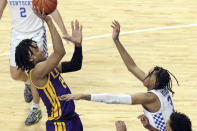 LSU's Trendon Watford, left, shoots as Kentucky's B.J. Boston defends during the first half of an NCAA college basketball game in Lexington, Ky., Saturday, Jan. 23, 2021. (AP Photo/James Crisp)