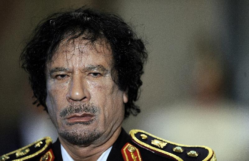"""Libya's Moamer Kadhafi unveiled his much-heralded """"third way"""" seven years after he led a group of Libyan army officers in a 1969 coup d'etat that toppled the monarchy (AFP Photo/Filippo Monteforte)"""