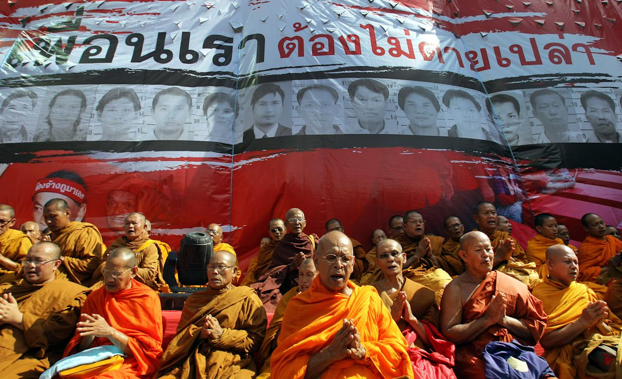 Buddhist monks attend a prayer session for Red Shirts victims in 2010 deadly street fighting, at Ratchaprasong Intersection in Bangkok, Thailand, Saturday, May 19, 2012. The Red Shirt protesters marked the second anniversary of the army's crushing of a two-month-long Red Shirt protest in central Bangkok, the most violent incident in political unrest that has wracked the country since Thaksin Shinawatra was ousted in a 2006 military coup. (AP Photo/Sakchai Lalit)
