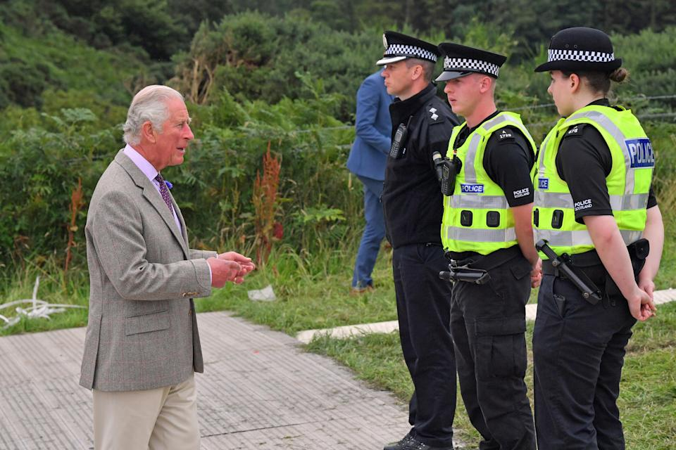 Charles meeting PC Eilidh McCabe (right) and PC Liam Mercer (second from right), the first two police officers who attended the scene of the ScotRail train derailment. (PA)