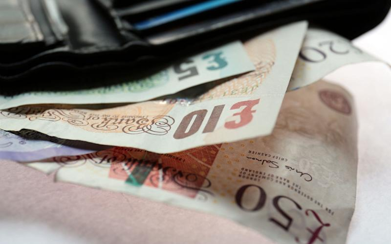 The gap between wage growth and inflation has squeezed UK households - PA