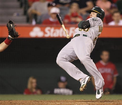 Oakland Athletics' Josh Donaldson jumps out of the way of a wild pitch against the Los Angeles Angels during the fifth inning of a baseball game in Anaheim, Calif., Monday, May 14, 2012. (AP Photo/Chris Carlson)