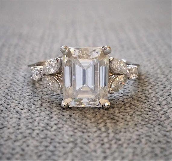 """<i><a href=""""https://www.etsy.com/listing/593633605/antique-ef-color-moissanite-engagement?ga_search_query=moissanite&ref=shop_items_search_26"""" target=""""_blank"""">Buy it fromPenelliBelle on Etsy</a> for$2,799.</i>"""