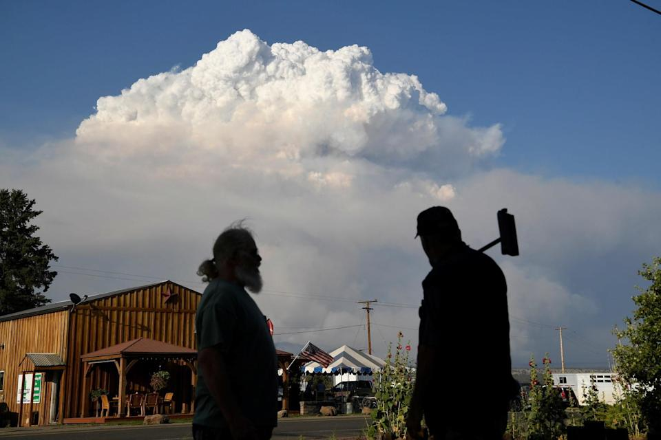 Residents of Lake View, Oregon, look out at plumes of smoke seen in the background on July 15.