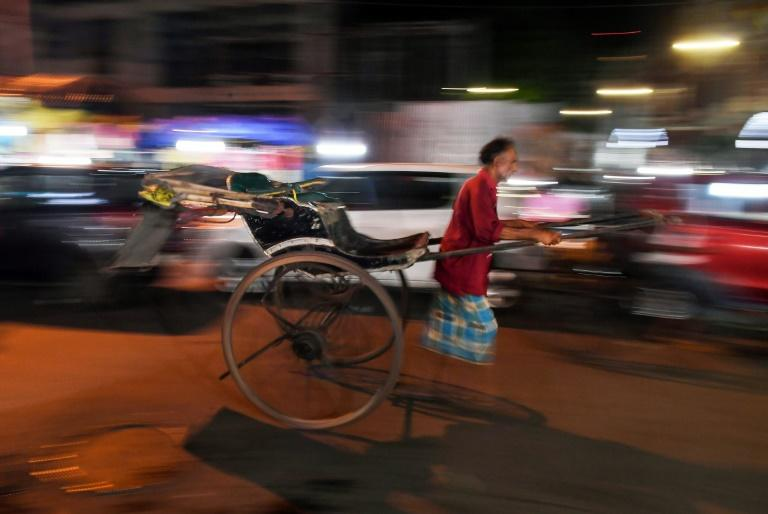 Rickshaw numbers are declining in Kolkata usurped by tuk tuks, the city's signature yellow taxis and modern conveniences like Uber