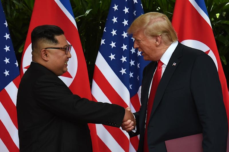 "A bullish Donald Trump has said people can ""sleep well"" after his summit with Kim Jong Un"