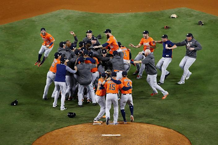 <p>NOV. 1, 2017 – Houston Astros celebrate defeating the Los Angeles Dodgers 5-1 in game seven to win the 2017 World Series at Dodger Stadium in Los Angeles, California. (Photo: Tim Bradbury/Getty Images) </p>