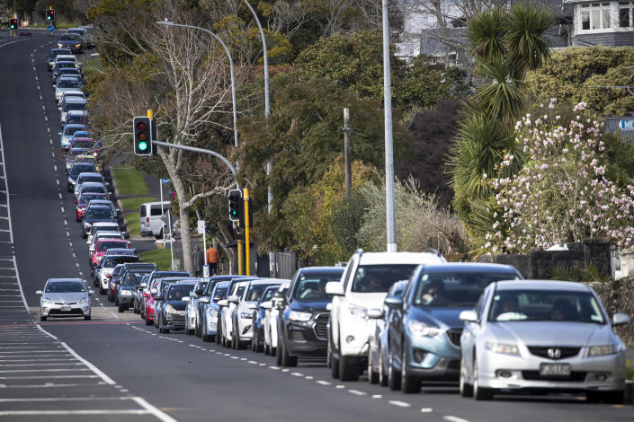 Vehicles line up for COVID-19 testing in Auckland, New Zealand, Thursday, Aug. 19, 2021. Japan, Australia and New Zealand all got through the first year of the coronavirus pandemic in relatively good shape, but now are taking diverging paths in dealing with new outbreaks of the fast-spreading delta variant. (Jason Oxenham/New Zealand Herald via AP)