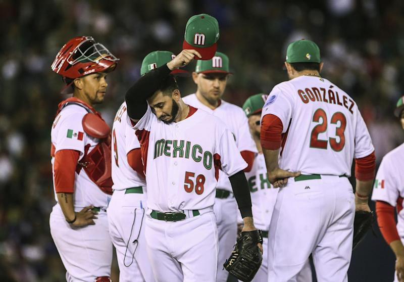 Mexico pitcher Miguel Gonzalez walks off the field after being relieved during the team's World Baseball Classic game against Puerto Rico in Guadalajara, Mexico, Saturday, March 11, 2017. (AP Photo/Luis Gutierrez)