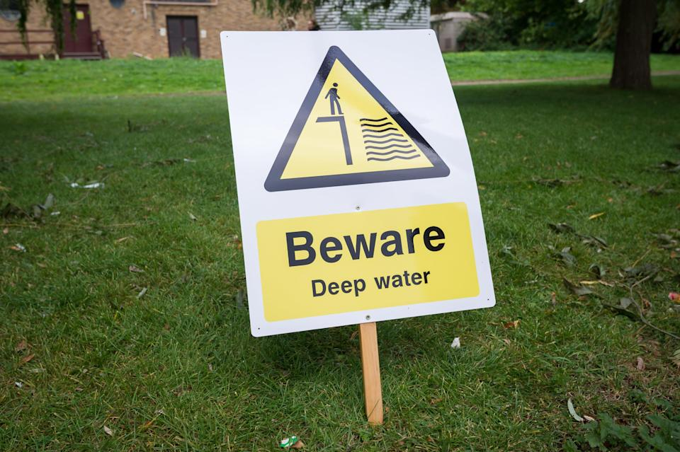 Signs warning of deep water that have been put at the spot where two year old Ruby was pulled out of the river Nene (SWNS)