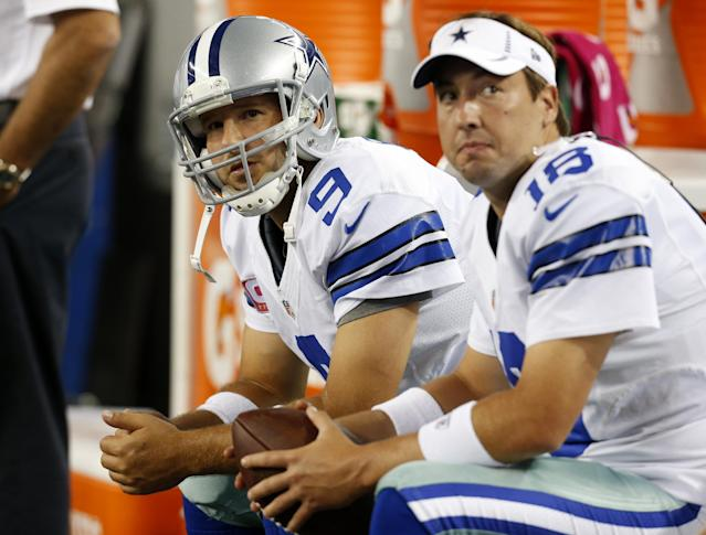 FILE - In this Monday Oct. 1, 2012 file photo, Dallas Cowboys' Tony Romo (9) and Kyle Orton (18) sit on the bench during an NFL football game against the Chicago Bears in Arlington, Texas. The Dallas Cowboys are releasing Kyle Orton after their backup quarterback missed all the offseason workouts amid reports that he was considering retirement, Tuesday, July 15, 2014. (AP Photo/Sharon Ellman, File)