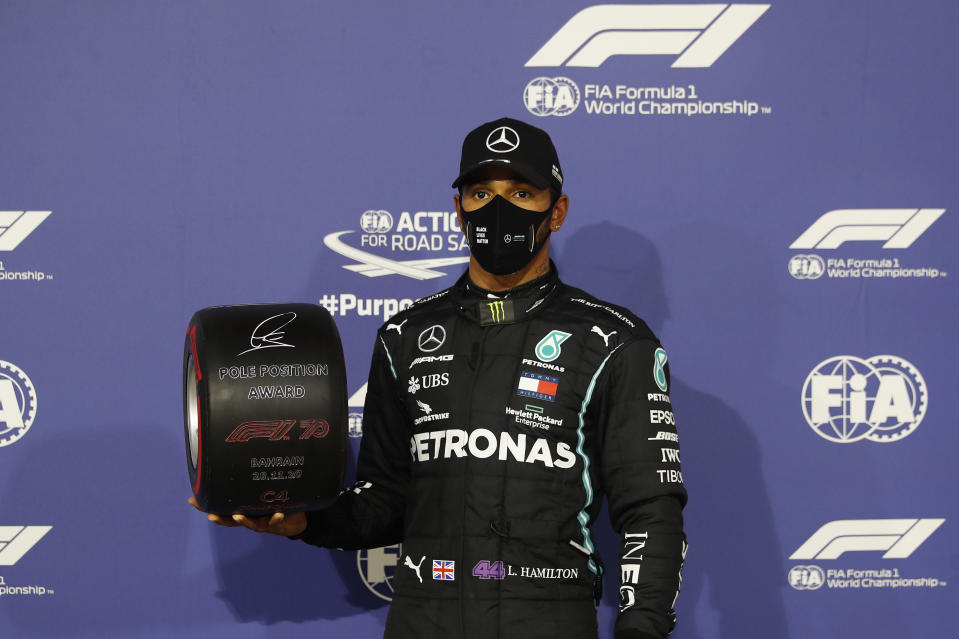 BAHRAIN, BAHRAIN - NOVEMBER 28: Pole position qualifier Lewis Hamilton of Great Britain and Mercedes GP poses with the pole position award in parc ferme during qualifying ahead of the F1 Grand Prix of Bahrain at Bahrain International Circuit on November 28, 2020 in Bahrain, Bahrain. (Photo by Hamad Mohammed - Pool/Getty Images)