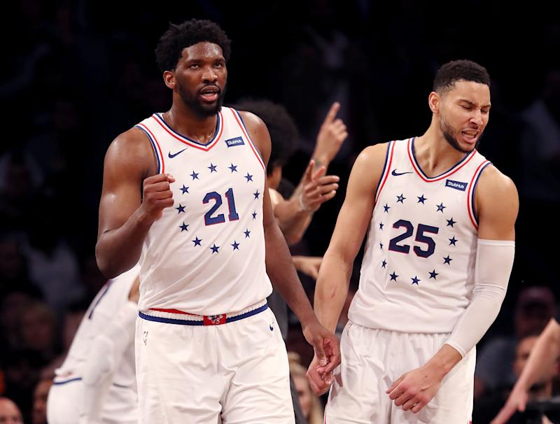 Joel Embiid #21 and Ben Simmons #25 of the Philadelphia 76ers celebrate in the final minutes of the fourth quarter against the Brooklyn Nets