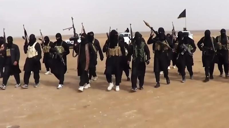 An image grab from a propaganda video uploaded on June 11, 2014 by jihadist group the Islamic State of Iraq and the Levant allegedly shows ISIL militants gathering at an undisclosed location in Iraq's Nineveh province