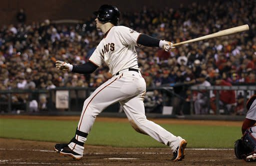 San Francisco Giants' Buster Posey singles off of St. Louis Cardinals pitcher Jaime Garcia to score Giants' Gregor Blanco during the sixth inning of a baseball game in San Francisco, Wednesday, May 16, 2012. (AP Photo/Jeff Chiu)