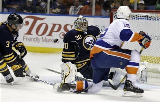 Buffalo Sabres goalie Ryan Miller makes a save on a shot by New York Islanders' Josh Bailey (12) during the second period of an NHL hockey game in Buffalo, N.Y., Tuesday, Feb. 21, 2012. (AP Photo/David Duprey)