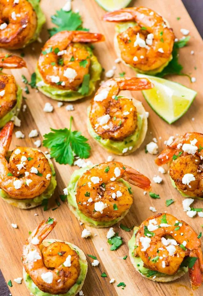 """<p>The shrimp cooks up in just five minutes, and from there, it's a quick assembly: simply stack guacamole (homemade or not) and shrimp on a tortilla chip.</p> <p><strong>Get the recipe:</strong> <a href=""""http://www.wellplated.com/spicy-shrimp-guacamole-bites"""" target=""""_blank"""" class=""""ga-track"""" data-ga-category=""""Related"""" data-ga-label=""""http://www.wellplated.com/spicy-shrimp-guacamole-bites"""" data-ga-action=""""In-Line Links"""">spicy shrimp guacamole bites</a></p>"""