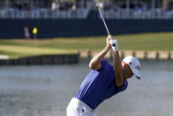 Justin Thomas hits his tee shot on the 17th hole during the final round of The Players Championship golf tournament Sunday, March 14, 2021, in Ponte Vedra Beach, Fla. (AP Photo/John Raoux)