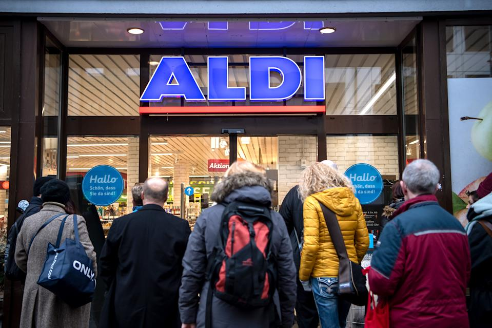 09 March 2020, Bremen: Early in the morning, customers are on the verge of opening in front of an Aldi market. Aldi sells cheap disinfectants as a special offer from the early morning. Due to the coronavirus, the demand for disinfectants has increased considerably. Photo: Sina Schuldt/dpa (Photo by Sina Schuldt/picture alliance via Getty Images)
