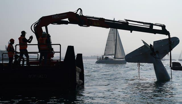 A crane lifts the plane from Poole harbour (Andrew Matthews/PA)