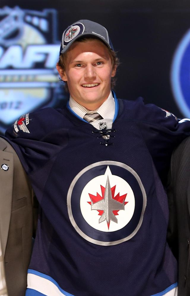 PITTSBURGH, PA - JUNE 22: Jacob Trouba, ninth overall pick by the Winnipeg Jets, poses on stage during Round One of the 2012 NHL Entry Draft at Consol Energy Center on June 22, 2012 in Pittsburgh, Pennsylvania. (Photo by Bruce Bennett/Getty Images)