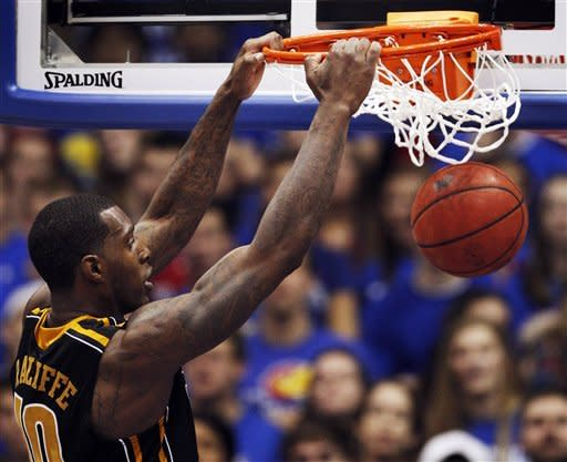 Missouri forward Ricardo Ratliffe (10) dunks during the first half of an NCAA college basketball game against Kansas in Lawrence, Kan., Saturday, Feb. 25, 2012. (AP Photo/Orlin Wagner)