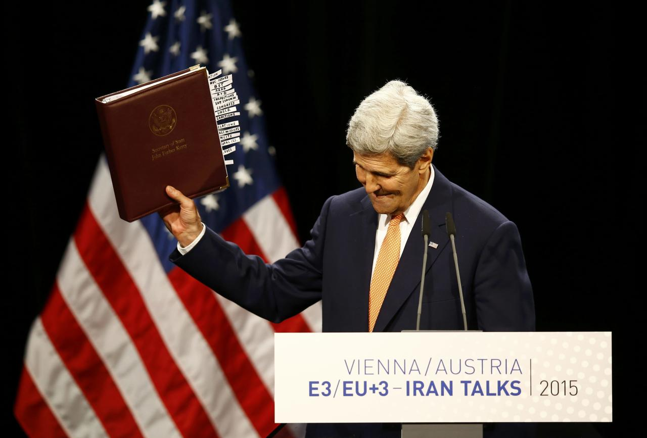 "U.S. Secretary of State John Kerry reacts as he delivers a statement on the Iran talks deal at the Vienna International Center in Vienna, Austria July 14, 2015. Iran and six major world powers reached a nuclear deal on Tuesday, capping more than a decade of on-off negotiations with an agreement that could potentially transform the Middle East, and which Israel called an ""historic surrender"". REUTERS/Leonhard Foeger"