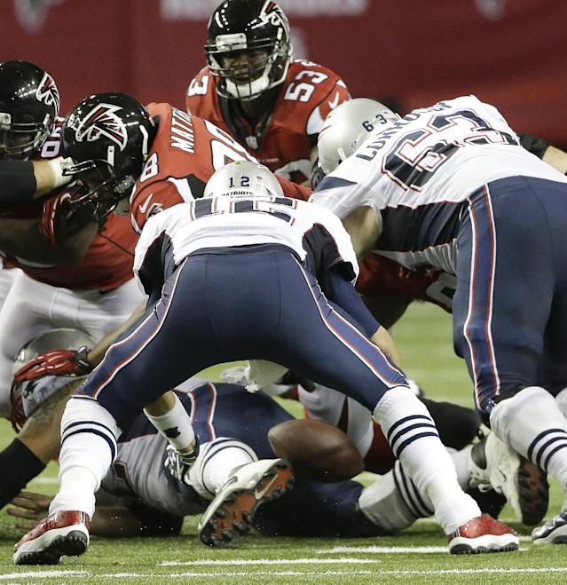 New England Patriots quarterback Tom Brady (12) drops the ball and fumbles against the Atlanta Falcons during the second half of an NFL football game, Sunday, Sept. 29, 2013, in Atlanta. (AP Photo/John Bazemore)
