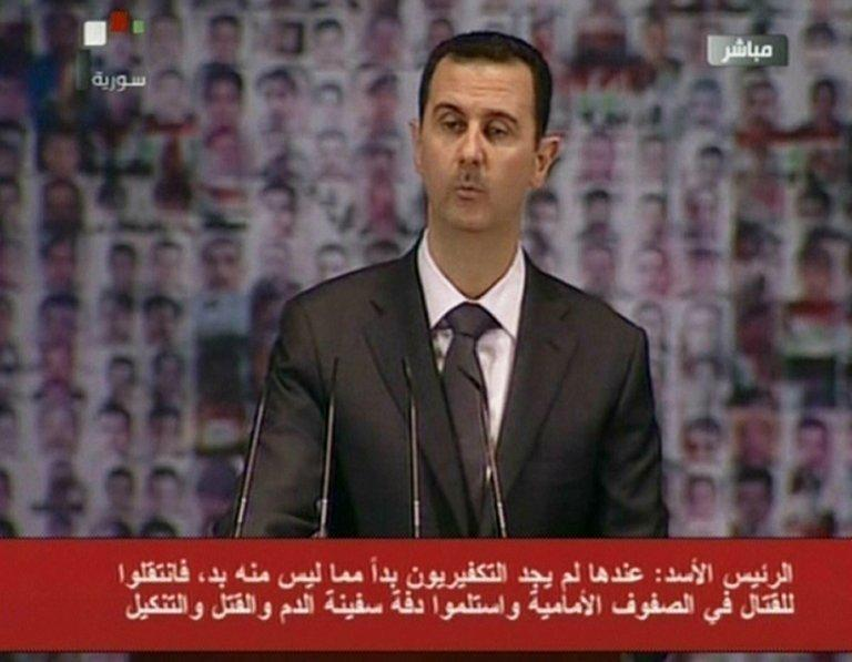 Image grab from state-run Syrian TV shows President Bashar al-Assad making a speech on January 6, 2013