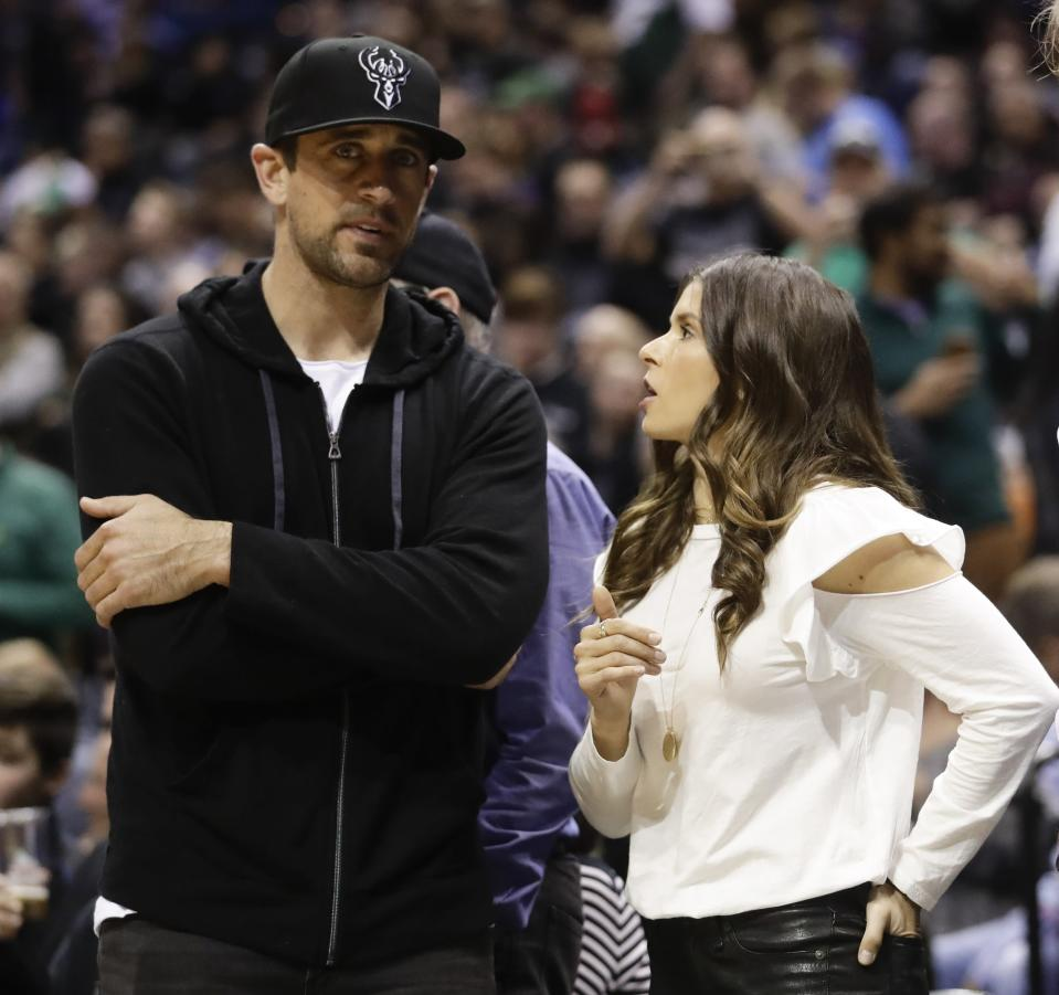 Aaron Rodgers and Danica Patrick were courtside for the Bucks' Game 3 versus the Celtics. (AP Photo/Morry Gash)