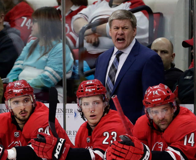 FILE - In this Feb. 6, 2018, file photo, Carolina Hurricanes coach Bill Peters reacts during the second period of an NHL hockey game against the Philadelphia Flyers in Raleigh, N.C. Peters has resigned as the Hurricanes coach after four seasons and no playoff berths. Peters announced his decision Friday, April 20, 2018, through the team, saying in a statement that this is a good time to move on.(AP Photo/Gerry Broome, File)